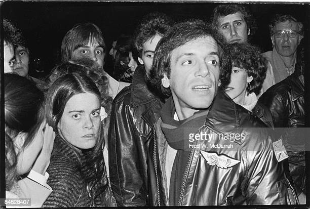 Surrounded by people American businessman and nightclub owner Steve Rubell looks through the crowd at his club Studio 54 New York New York February...