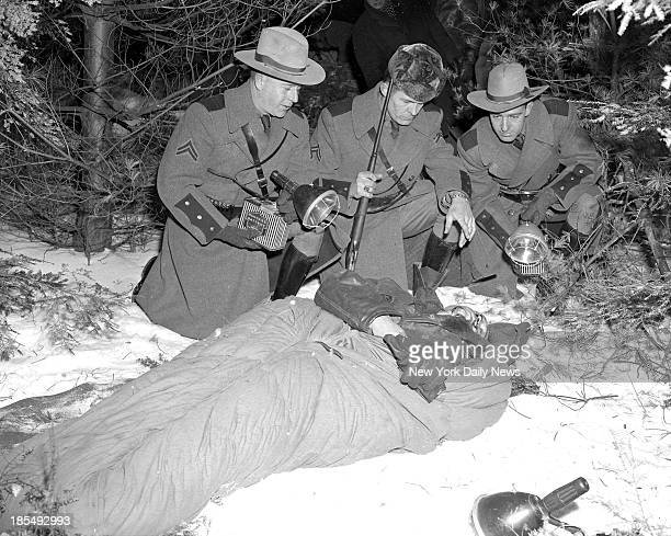 Surrounded by pine trees of Catskill Mountains State Police Corp over Alphonse Rocco body after gangster was felled by fusillade