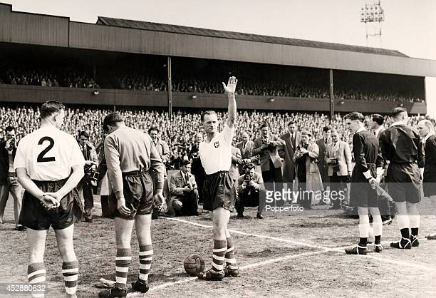 Surrounded by players and members of the press, Tom Finney of Preston North End waves his last farewell to the crowd at Deepdale Stadium in Preston...