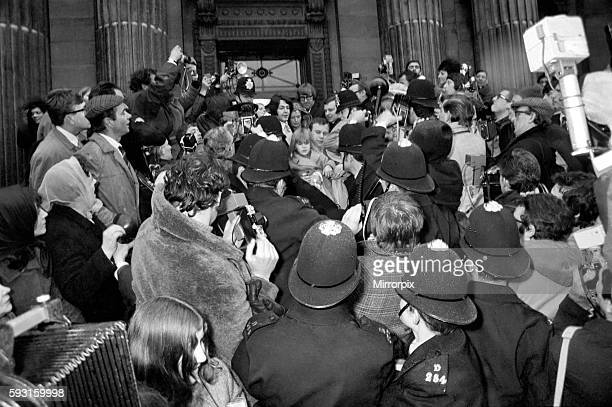 Surrounded by pressmen police and fans the bride and groomPaul and Linda leave Marylebone register office March 1969 Z02419006