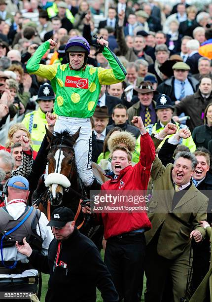 Surrounded by racing fans Ruby Walsh on Kauto Star celebrates after winning the Totesport Cheltenham Gold Cup Chase during the 2009 Cheltenham...
