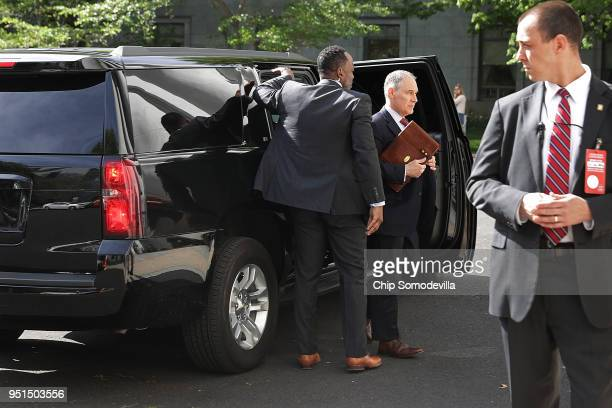 Surrounded by security agents Environmental Protection Agency Administrator Scott Pruitt steps out of his armored SUV as he arrives to testify before...