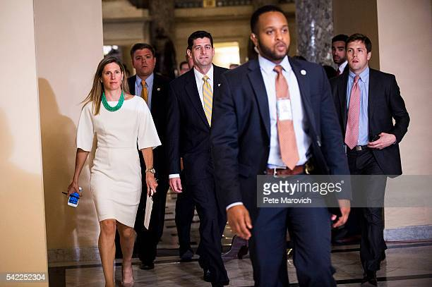 Surrounded by security and staffers Speaker of the House Paul Ryan makes his way to the House floor to call for a vote in an effort to break up a...