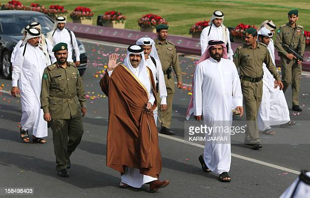 Surrounded by security, Qatari Emir Sheikh Hamad bin Khalifa al-Thani arrives to attend the Gulf emirate's National Day celebrations in Doha on...