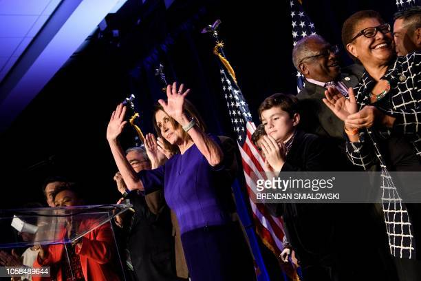 Surrounded by supporters House Minority Leader Nancy Pelosi celebrates a projected Democratic Party takeover of the House of Representatives during a...