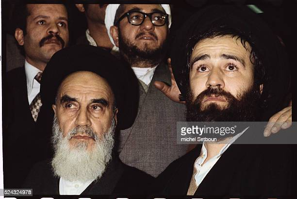 Surrounded by supporters the Ayatollah Khomeini returns to Tehran from exile