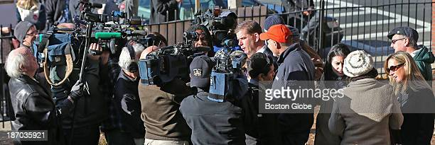 Surrounded by the media Rep Marty Walsh voted with his partner Lorrie Higgins and her daughter Lauren Campbell at the Cristo Rey School 100 Savin...