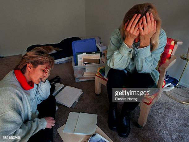 Surrounded by their medical records in a scarcely furnished bedroom roomates Julie Coefield left and Susan Blanton right are overcome with emotion as...