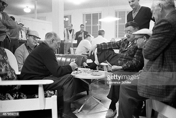 Surrounded by unidentified others American baseball player and manager Leo Durocher of the Los Angeles Dodgers plays cards with team owner Walter...