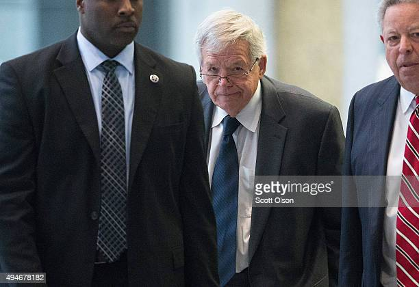 Surrounded by US Marshals former Republican Speaker of the House Dennis Hastert leaves the Dirksen Federal Courthouse on October 28 2015 in Chicago...