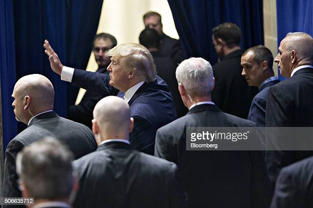 Surrounded by US Secret Service agents Donald Trump president and chief executive of Trump Organization Inc and 2016 Republican presidential...