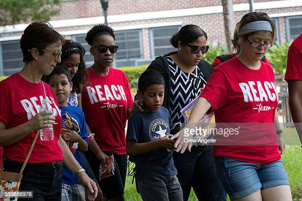 Surrounded by volunteers family and friends of the victims of the Pulse Nightclub shooting leave the Beardall Senior Center where they gathered to...
