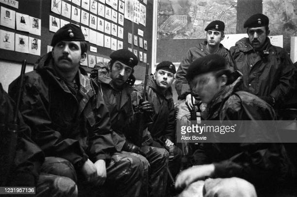 Surrounded by wanted posters of IRA men and women in the Ops Room of a British Army Base, a squad of British soldiers hear an intelligence briefing...