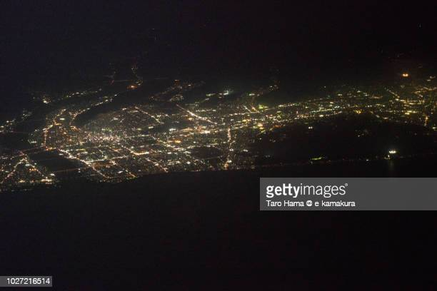 Suruga Bay and center of Shizuoka city in Japan night time aerial view from airplane