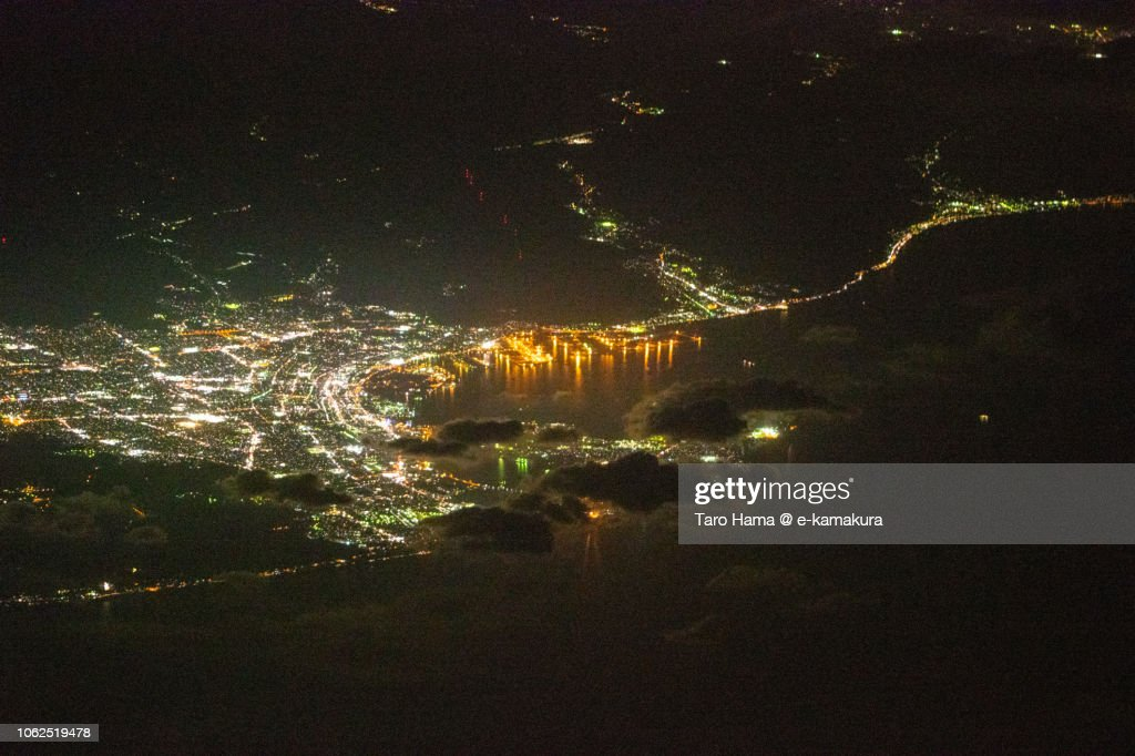 Suruga Bay and Shimizu Harbor in Shizuoka city in Japan night time aerial view from airplane : ストックフォト