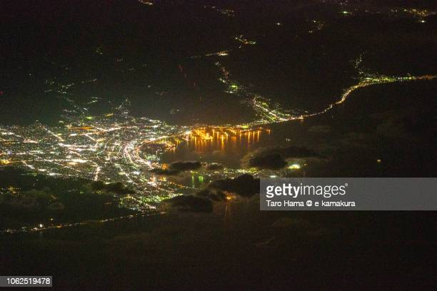 Suruga Bay and Shimizu Harbor in Shizuoka city in Japan night time aerial view from airplane