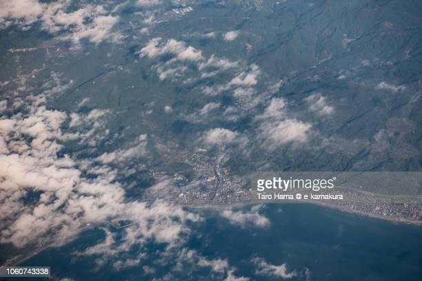 Suruga Bay and Shizuoka city (Yui and Kanbara area) in Shizuoka prefecture in Japan daytime aerial view from airplane