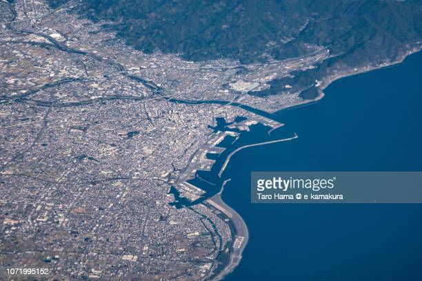 Suruga Bay and Yaizu city in Shizuoka prefecture in Japan daytime aerial view from airplane