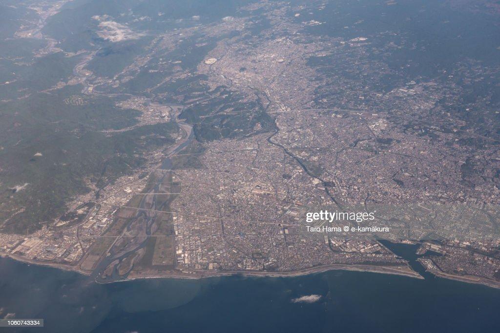 Suruga Bay, Fuji and Fujinomiya cities in Shizuoka prefecture in Japan daytime aerial view from airplane : ストックフォト