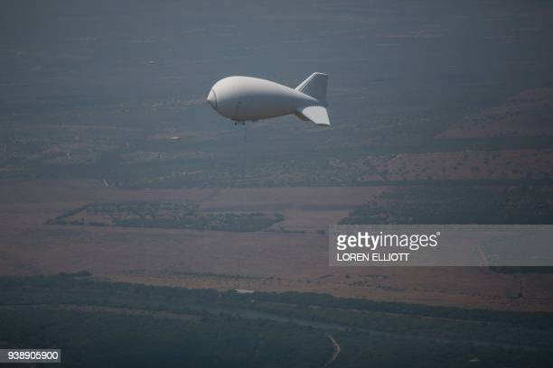 TOPSHOT A surveillance balloon by the USMexico border is pictured on March 27 2018 in the Rio Grande Valley Sector near McAllen Texas