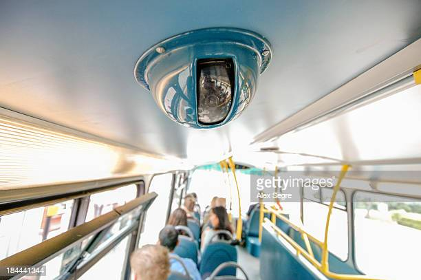 Surveillance camera on top deck of double decker bus, London