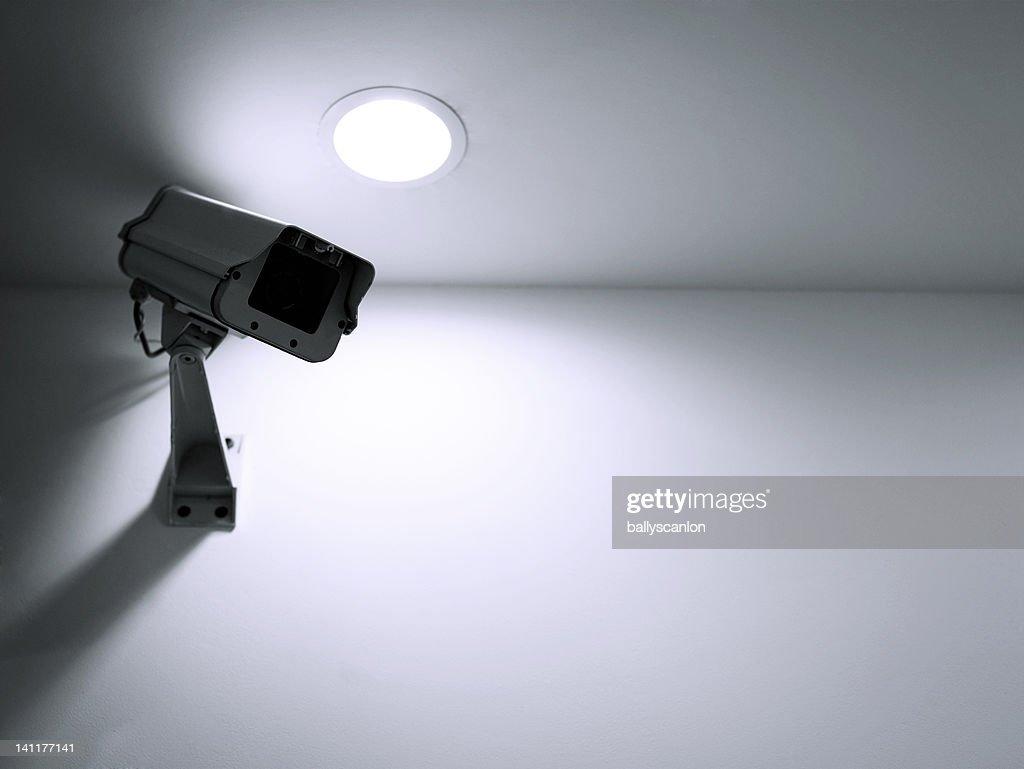 Surveillance camera on wall indoors : Foto de stock