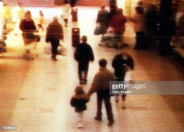 A surveillance camera shows the abduction of twoyearold James Bulger from the Bootle Strand shopping mall February 12 1993 at 342pm near Liverpool...
