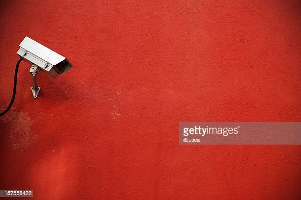 Surveillance camera with red wall