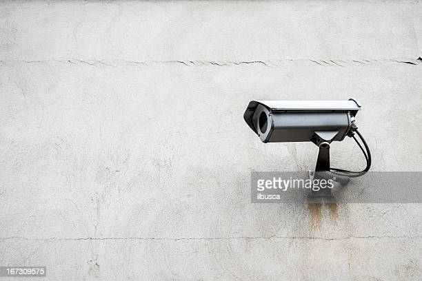 Surveillance camera with wall