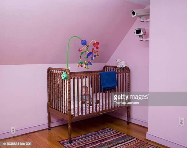 Surveillance cameras over baby (6-9 months) in crib