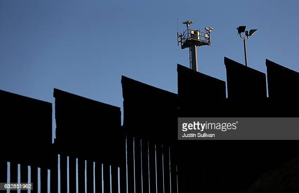 Surveillance cameras stand above the USMexican border fence at Playas de Tijuana on January 27 2017 in Tijuana Mexico US President Donald Trump...