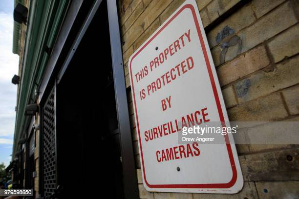Surveillance signage is displayed on a door to the Cayuga Center in East Harlem a facility currently accepting children separated from their families...