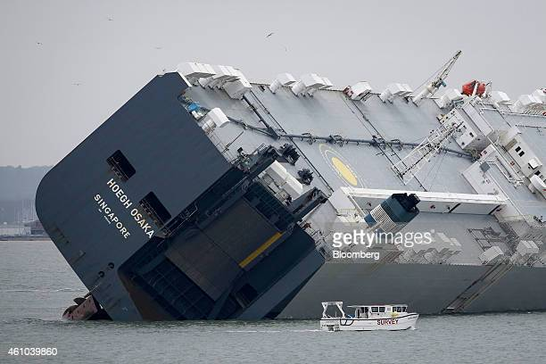 A survey boat passes the stern of the Hoegh Osaka ro-ro