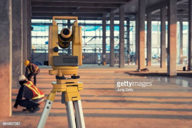 survey equipment in construction site - land stock pictures, royalty-free photos & images