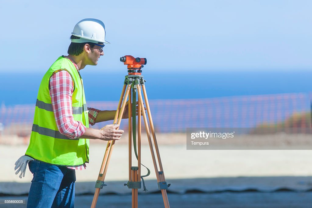 Surveying on the construction site. : Bildbanksbilder