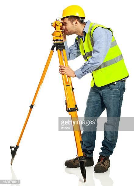 surveyor apprentice - surveyor stock photos and pictures