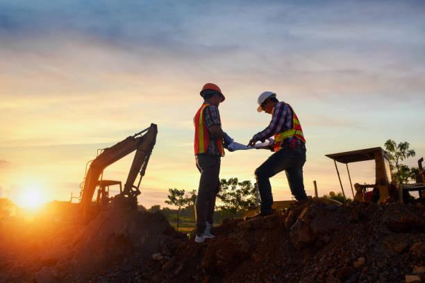 surveyor engineer worker making measuring  on road works