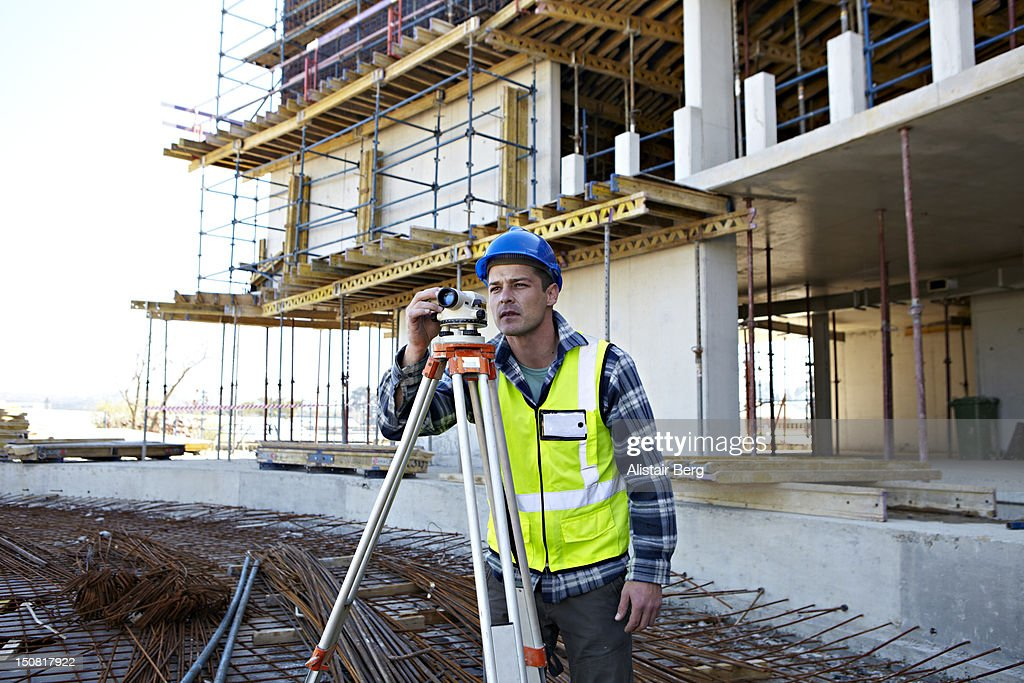 Surveyor on a building site : Stock Photo