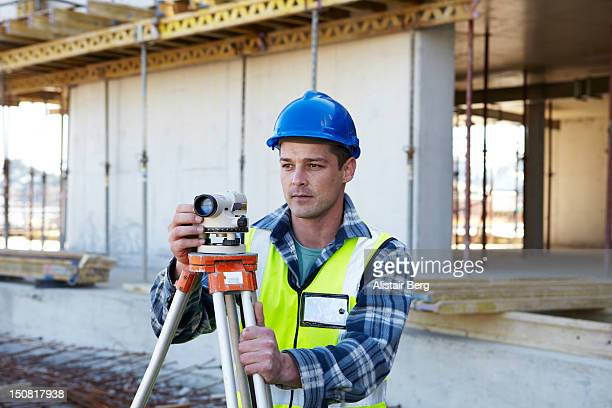 Surveyor on building site