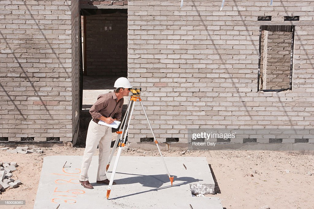 Surveyor on construction site : Stock Photo