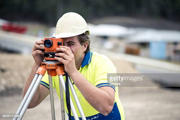 Surveyor on construction site