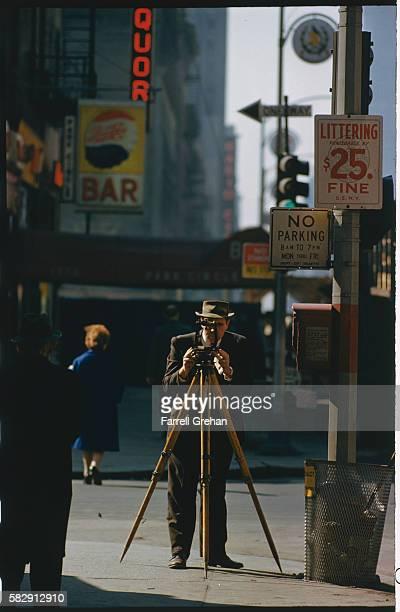 Surveyor on the Sidewalk