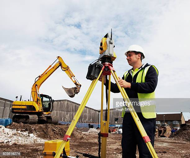 surveyor using theodolite on construction site - hugh sitton stock pictures, royalty-free photos & images