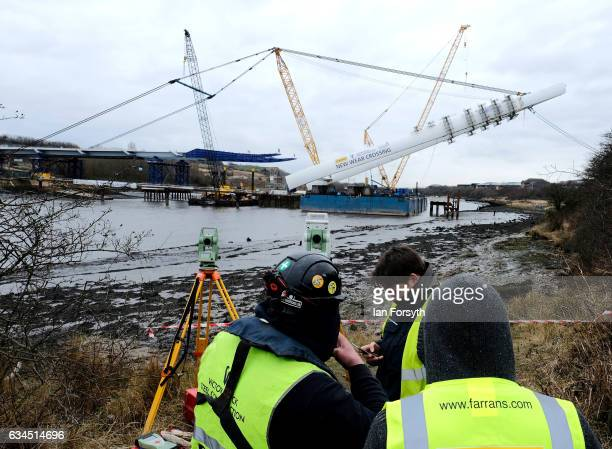 Surveyors monitor progress as the final 100 metre centrepiece of Sunderland's new River Wear crossing is lifted into place on February 10 2017 in...