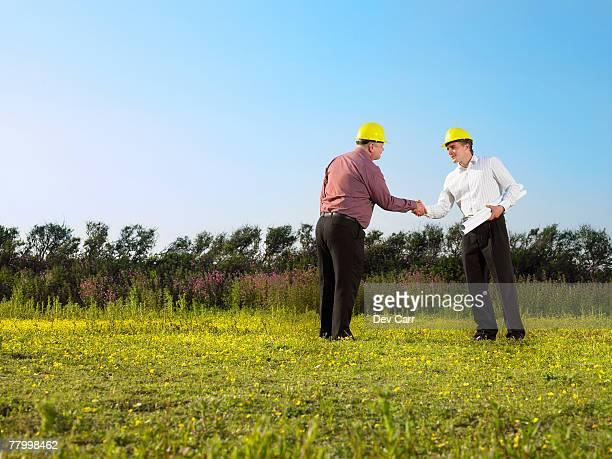 Surveyors on a field.