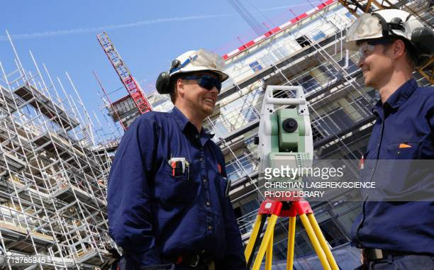 Surveyors using theodolite on site