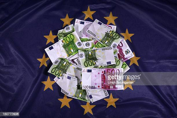 GERMANY BONN survival package of the EU for the financially suffering member states Our picture shows bank notes in Euros on the Flag of Europe