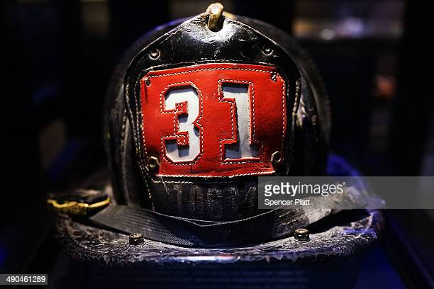 Surviving firefighter Dan Potter's fire helmet which he used at Ground Zero on September 11 is viewed during a tour the National September 11...