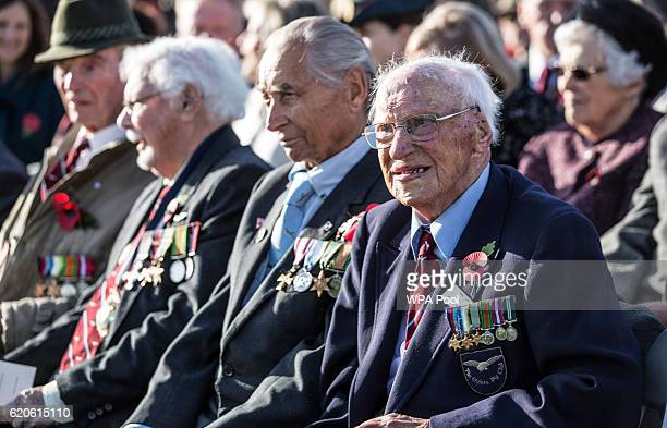 Surviving 'Guinea pig club' member Des O'Connell sits with other survivors as he waits for Prince Philip Duke of Edinburgh President of the Guinea...