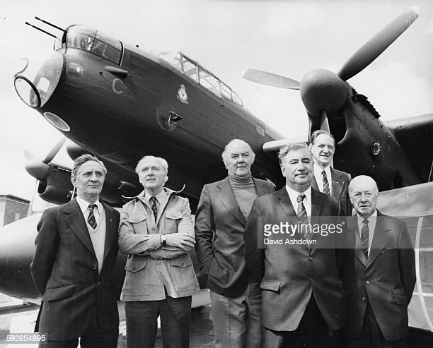 Surviving members of the Dambusters 617 Squadron standing in front of a Lancaster Bomber Ernie Twells Bill Townsend Ivan Whittaker Bill Howarth...